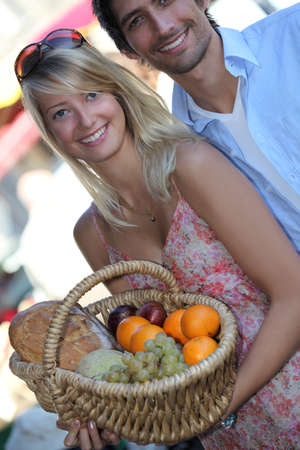 Couple buying fruit photo