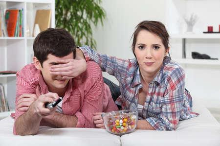 hogging: Woman blocking her boyfriend Stock Photo
