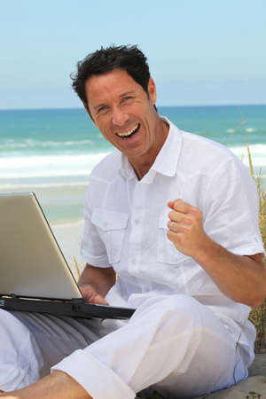 Man happy working on the beach. photo