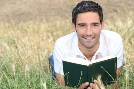 take it easy: Man reading outside