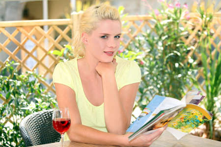 Woman sitting on a terrace with a glass of wine photo
