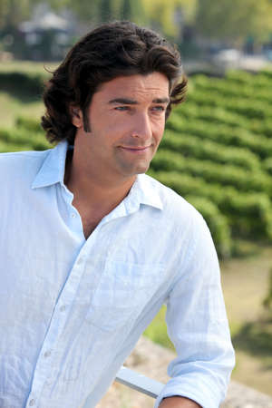 proprietor: Man standing over a vineyard Stock Photo