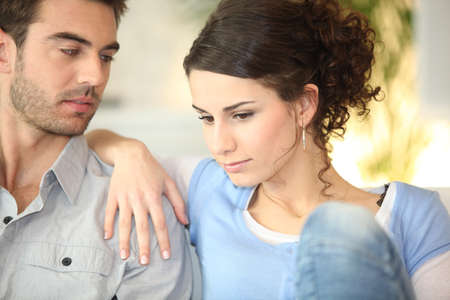 finance problems: Concerned young couple Stock Photo