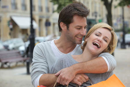 shopping trip: Couple laughing with joy on a shopping trip Stock Photo