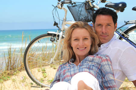 free time: couple on the beach with bikes