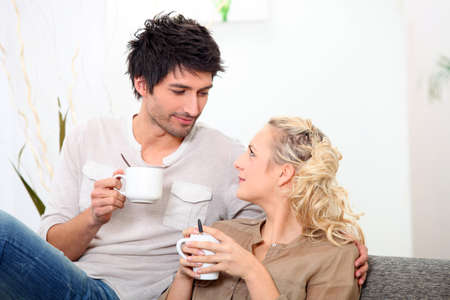 Couple having a cup of coffee together in the morning Stock Photo - 12057762