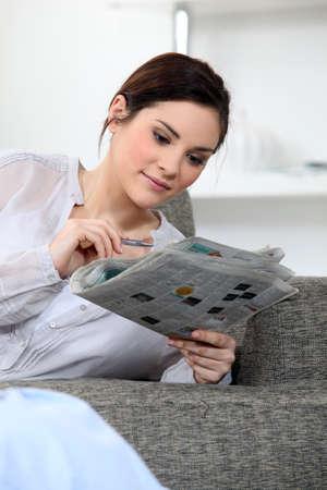 sudoku: Woman doing the crosswords Stock Photo