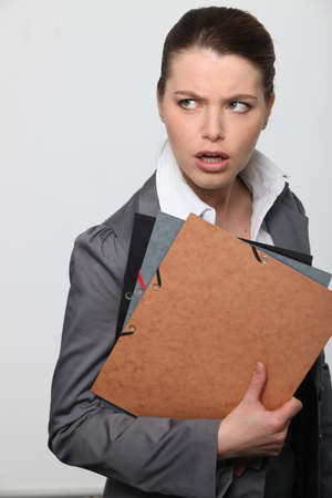 Confused office worker with paperwork photo