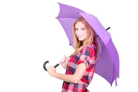 Pretty young woman under a bright purple umbrella Stock Photo - 12057500