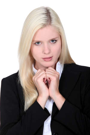 fidgety: Blond business woman awaiting result of interview