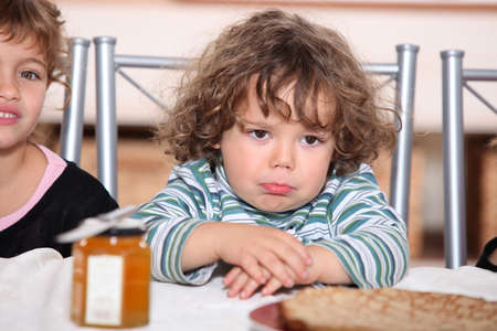 griping: Grumpy toddler waiting to eat pancakes