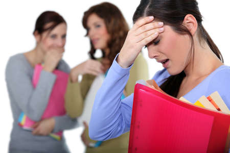 nasty: two female colleagues mocking a woman in trouble