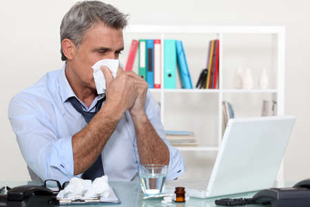 Office worker suffering from a cold photo