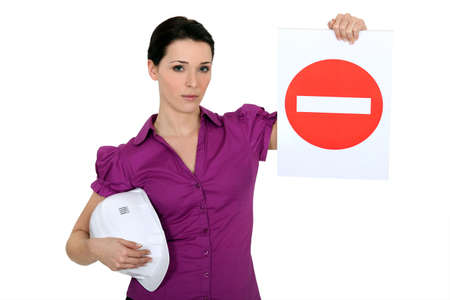 Woman holding a no entry sign Stock Photo - 12057444