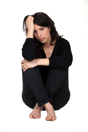 restless: Woman sitting pensively