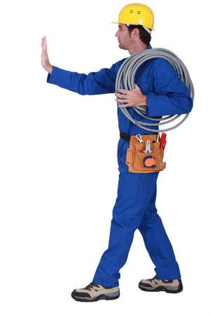 journeyman technician: Electrician making a stop sign.