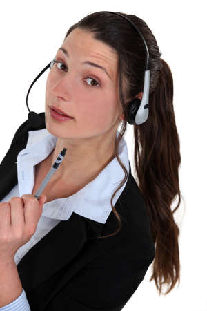 dissuade: Portrait of a call centre agent Stock Photo