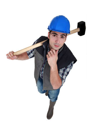 Man with sledge-hammer thinking Stock Photo - 12057428
