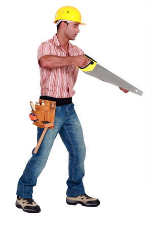 sideway: A male carpenter with a handsaw.