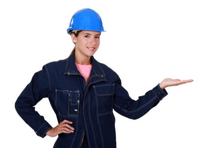 Manual worker holding out her hand in empty copyspace photo