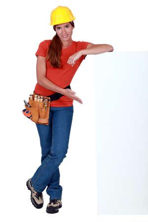 craftswoman: craftswoman presenting a blank ad board