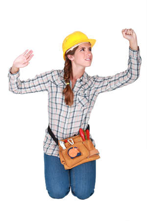 non verbal communication: Tradeswoman confined by a transparent wall