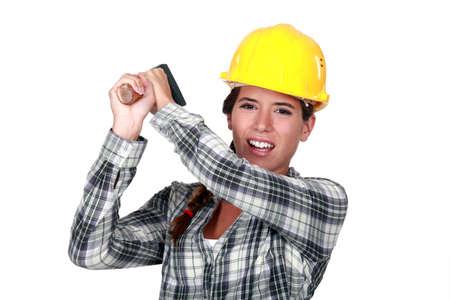 craftswoman: craftswoman striking with a hammer Stock Photo