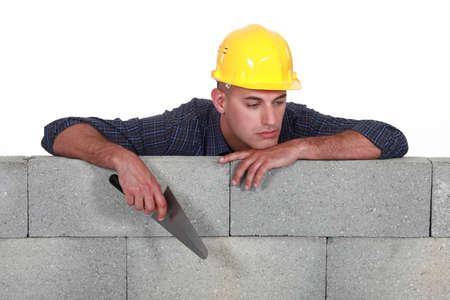 unhappy worker: A bored mason. Stock Photo