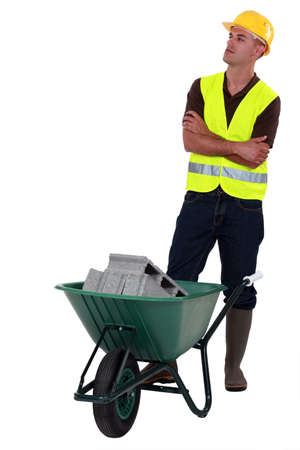 Construction worker with a wheelbarrow Stock Photo - 12057440