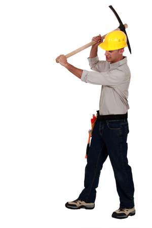 taskmaster: craftsman striking with his pick