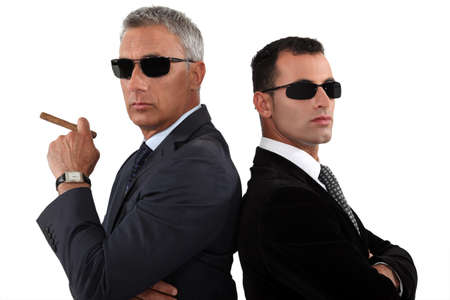 secret agent: Powerful businessmen in sunglasses