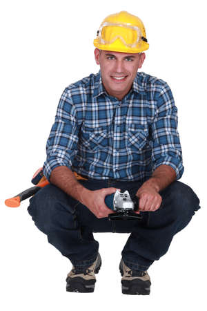 Man holding angle-grinder photo