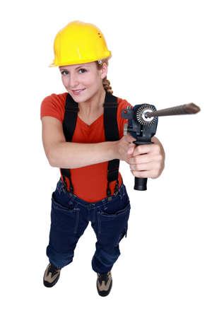 craftswoman: craftswoman holding a drill