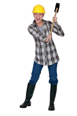 Woman with a sledgehammer Stock Photo - 12057502