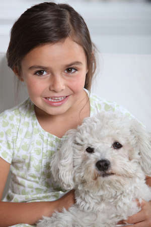 child with a dog photo