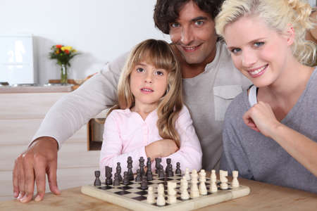Family playing chess photo
