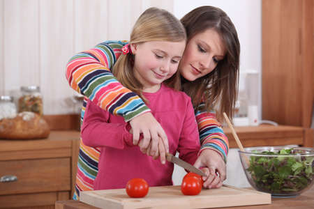 mother and daughter cooking together Stock Photo - 12057733