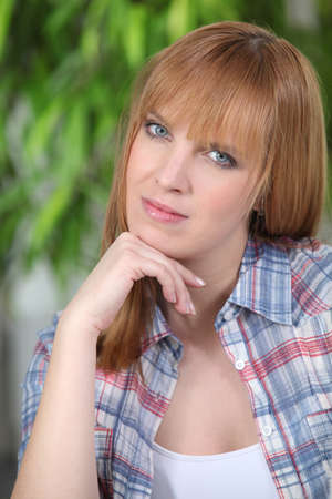 Portrait of a young redhead woman with blue eyes Stock Photo - 12057916