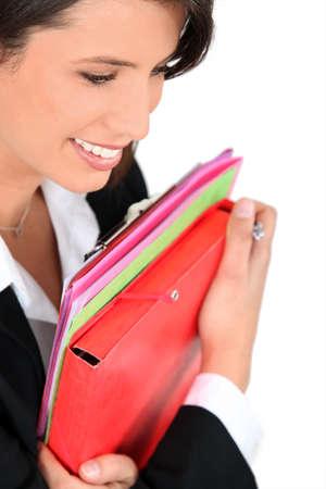 Businesswoman holding folders photo