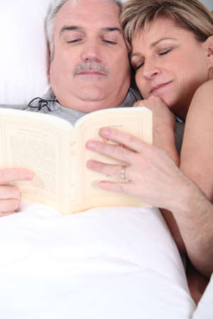 slumberous: Husband and wife cuddling