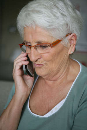 Old lady making phone call photo