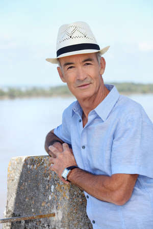 boomer: A mature man by the seashore. Stock Photo