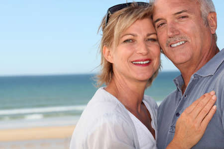 happy mature couple: Happy couple at the beach