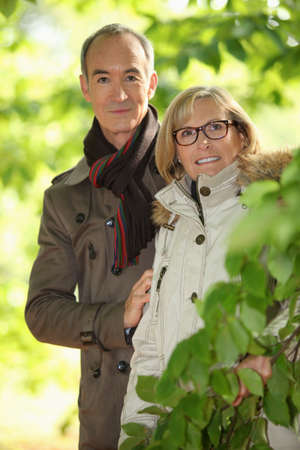 senior couple walking in the forest photo