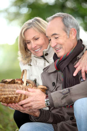 ramble: mature couple after ramble in the woods