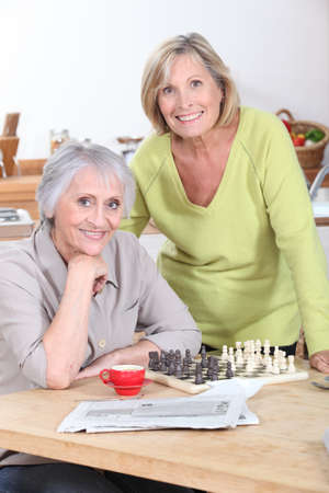 Two women playing an informal game of chess photo