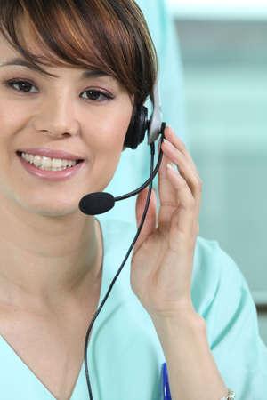 ear phones: Hospital worker wearing head-set