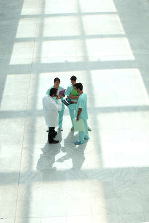 Hospital staff in hallway, top view photo