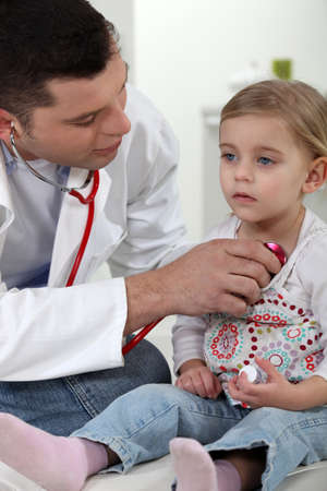 A little girl at the doctor. photo