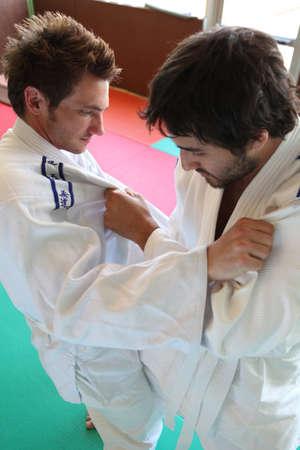 Men practicing judo photo